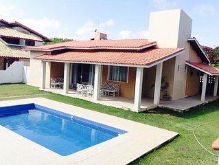 Casa 4 suites Guarajuba. 100m da praia. Condominio Paraiso.