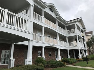 Peaceful 2 bedroom Barefoot Resort - shuttle to beach- close to attractions