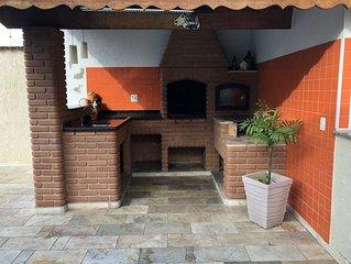 Bonita Casa na praia a 90 metros do mar, com Piscina, churrasqueira e Wi-fi.