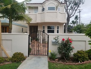 Beautifully renovated, spacious home walking distance to beach, restaurants.