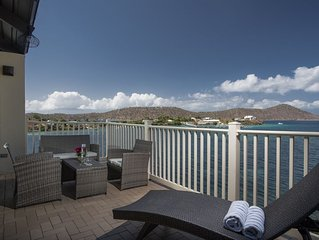 Top floor waterfront luxury near pool & beach. Rate inc. cleaning fee. B11