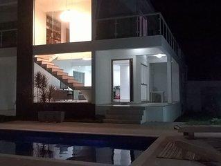 Casa moderna c\ piscina e vista para o mar. Nao anuncio na OLX