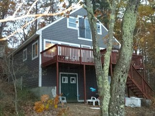 Lakefront Cottage with 100' Sandy Beach, Dock, Views and Game Room.