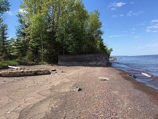 Large coastal farmhouse on Lake Superior with gorgeous secluded beach.