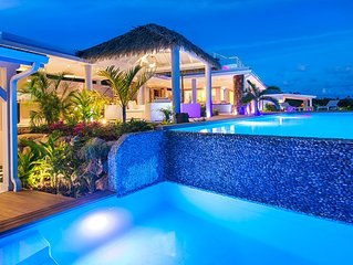 A four bedroom tropical paradise nestled in the verdant landscape of Terres Bass