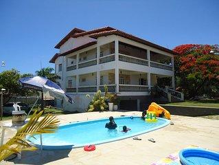 Ampla casa para reunir família e amigos praia, churrasco, piscina e área verde