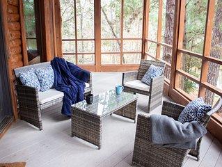 Relaxation awaits!  Fun getaway experience, 2/2 log cabin on the lake