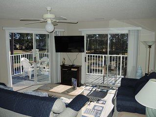 Perfect Two Bedroom Condo with 4 Queen Beds overlooking the 8th hole on the Magn