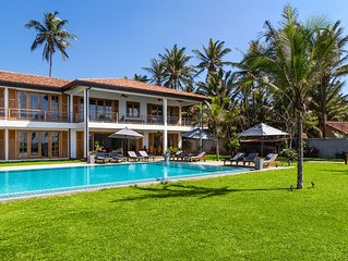 exclusive use of luxury fully staffed beach front 4 bed villa with private pool