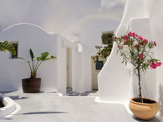Charming white cycladic cave house in traditional settlement