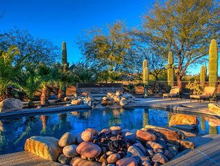 A majestic home on a beautiful expansive 2.3 acre lot surrounded by desert lands