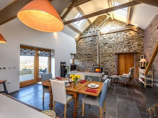 A breathtaking and stylish barn conversion lying on a private estate on the outs