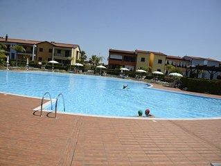 POSEIDONE-AppartamentI raffinati in villaggio con piscina