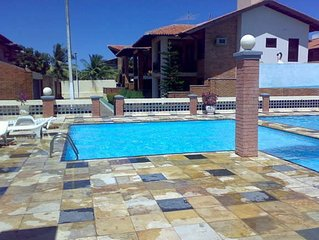 Big vacation house with shared pool, sportsfield and safe area close to beach.