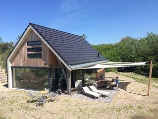 Gloednieuwe 8-persoons villa met sauna direct aan het strand in Ouddorp
