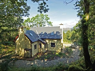 Detached cottage, in traditional style, quiet and secluded in wooded setting wit