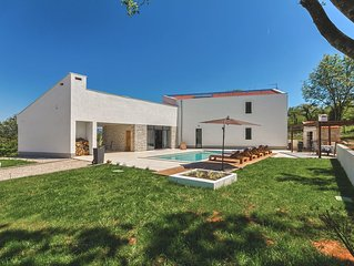 Modern peaceful villa with large pool in green surroundings offering privacy
