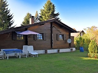 Detached wooden house with fireplace and large garden near Bad Wildungen