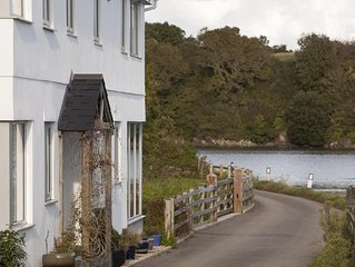 Beautiful modern  house on banks of River Lynher offering absolute tranquility