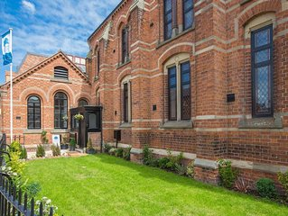 Luxury chapel apartment within Chester city walls, with parking.