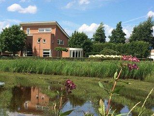 Luxe en stijlvolle villa in Natuurpark omgeven door flora&fauna. Centr.ligging.