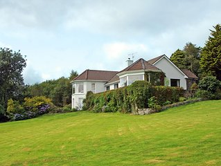 Semi-detached bungalow facing south in two acres of mature gardens with magnific