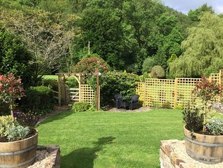 Peaceful wooded valley close to Exmoor. Luxury Lodge perfect for two.