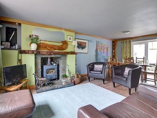 This painted stone cottage, semi-detached to another, is full of character and o