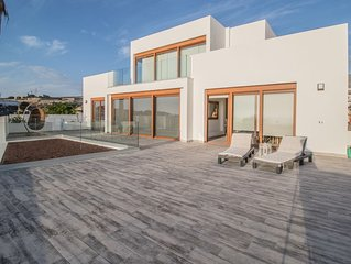 Fabulous contemporary 5 bedroom villa with private heated pool, sleeps max 13