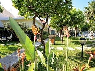 Casa Vacanza NETTUNO in villa con giardino. Un'oasi di relax vicino alle spiagge