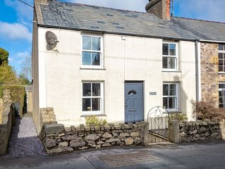 This pretty painted end terrace cottage presents a stylish, warm and welcoming h