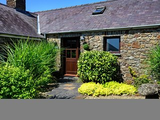 In a landscaped courtyard setting in central Pembrokeshire, this stone barn conv