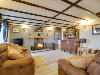 Look out over farmland to the sea from this welcoming and relaxing cottage down