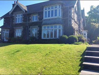 House On The Shore Of Lake Windermere with large garden & direct lake access &
