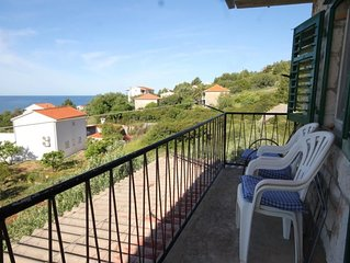 Two bedroom apartment with terrace and sea view Zavala (Hvar) (A-8802-b)