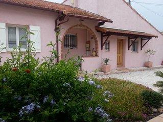 Maison individuelle comportant 2 appartements avec jardin et terrasse