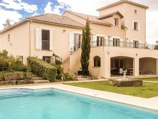 Spacious luxury villa with private heated pool and sauna at an golf course.