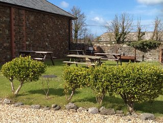 Olive Tree is an Ironstone Barn in a rural setting close to Widemouth Beach.