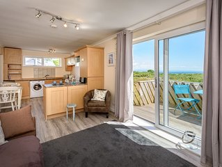 A lovely couples retreat with far reaching sea and countryside views from the sp