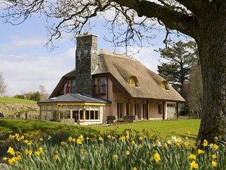 Chocolate box thatched cottage on five star luxury Resort