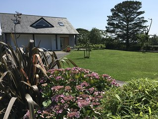 Spacious property with meadow and sea views.