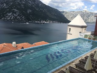 2 bedroom apartment with private beach and swimming pool in Kotor Bay