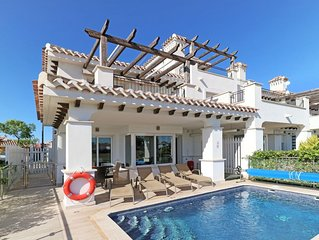 Beautiful 2 bed villa with stunning golf views, private pool, TV, WiFi, and A/C