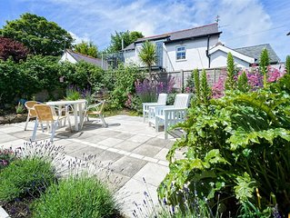 Positioned at the top of Abersoch's high street, this welcoming two-storey apart