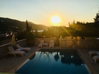 Large luxury villa with prime private location in Kassiopi. Panoramic views.