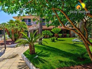 Bellissima villa con piscina a pochi passi dalla spiaggia  di Seccagrande