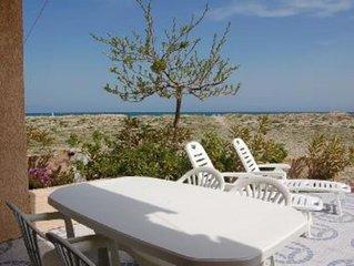 Villa en front de mer les pieds dans le sable