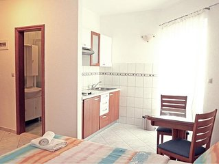 Studio apartment with balcony 130m from beach