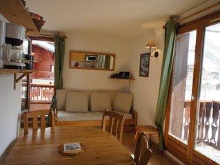Studio cabine dans residence, au centre du village, plein sud, parking compris