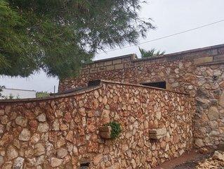 Antico CASEDDHU ristrutturato in pietra a ridosso del mare